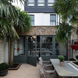 Photo of a medium sized classic back patio in London with no cover.