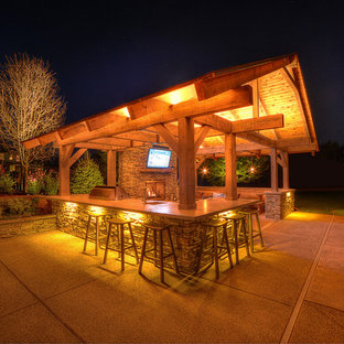 This is an example of a large arts and crafts backyard patio in Other with an outdoor kitchen and a gazebo/cabana.