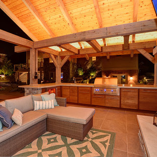 Design ideas for a large arts and crafts backyard patio in Other with an outdoor kitchen and a gazebo/cabana.