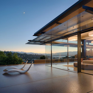 Inspiration for a large contemporary front yard patio remodel in San Francisco with a roof extension