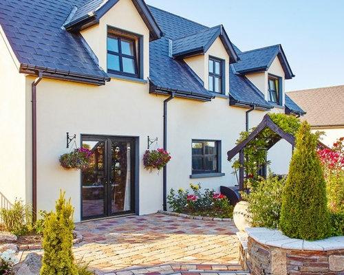 Foto e idee per facciate di case facciata di una casa in for Idee casa stucco