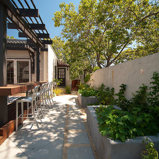 Inspiration for a mid-sized contemporary side yard patio remodel in San Francisco with decking and a pergola