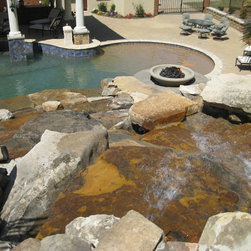 Tivoli Fire bowls - Three different sizes Tivoli fire bowl in three different colors. The landscape and pool designed and built by Affluent Pool Design & construction. Photo credit to Affluent Pool Design & construction.