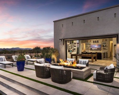 example of a trendy backyard tile patio design in phoenix with a fire pit - Deck Ideen Design