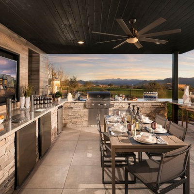 Inspiration for a contemporary backyard patio kitchen remodel in Phoenix