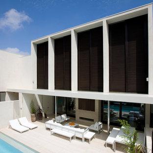 Patio - mid-sized modern backyard stone patio idea in Melbourne