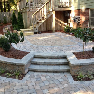 Patio - mid-sized traditional backyard concrete paver patio idea in Richmond with no cover
