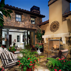Mediterranean Patio by Rustic Fire Place