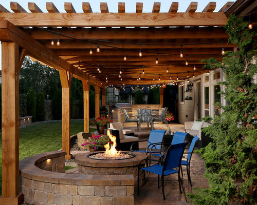 Mid Sized Rustic Backyard Patio Idea In Boise With Stamped Concrete And A  Pergola