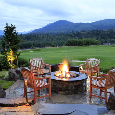 Inspiration for a timeless patio remodel in Seattle with a fire pit