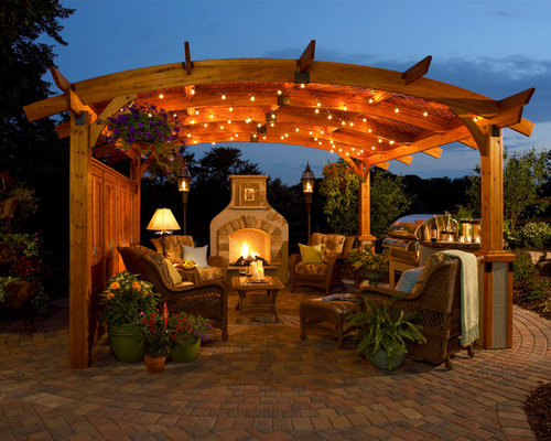Large Traditional Backyard Stone Patio Idea In Other With A Fire Pit And A  Pergola