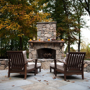 Elegant patio photo in Boston with a fire pit