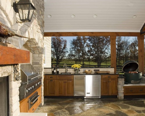 Elegant Patio Photo In Other With A Fire Pit And A Pergola