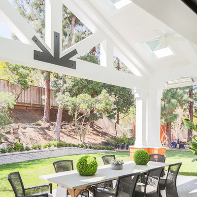 Transitional backyard patio photo in Orange County with a roof extension