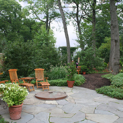Patio - traditional stone patio idea in Chicago with no cover