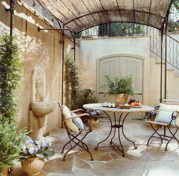 Mediterranean Patio by Barnes Vanze Architects, Inc