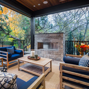 Design ideas for a transitional patio in Seattle with a roof extension.