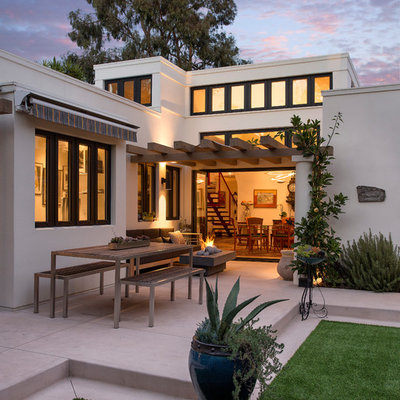 Inspiration for a mid-sized mediterranean backyard concrete patio remodel in Santa Barbara with a fire pit and a pergola
