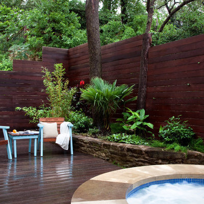 Inspiration for a contemporary patio remodel in Austin with decking and no cover