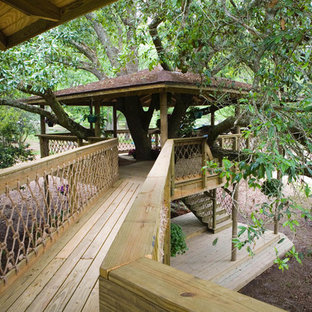 Patio - huge traditional backyard patio idea in New Orleans with a pergola