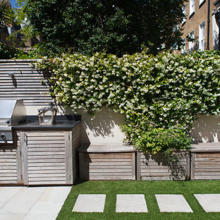 Photo of a small classic back patio in London with an outdoor kitchen and no cover.