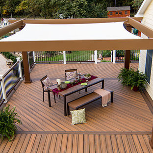 Mid-sized trendy backyard patio kitchen photo in Miami with decking and a pergola
