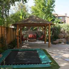 Tropical Patio by Belle Terre Landscapes