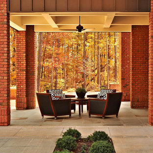 Example of a trendy backyard patio design in Raleigh