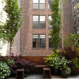 Example of a trendy patio design in New York with decking