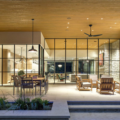 Inspiration for a large contemporary backyard tile patio kitchen remodel in Austin with a roof extension