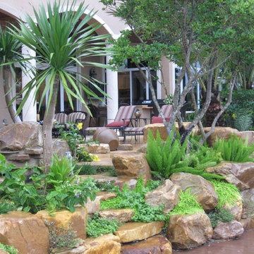 Tropical backyard rock garden wall
