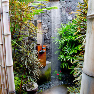 Example of an island style outdoor patio shower design in Hawaii
