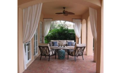 Tropical Patio by Lorrie Browne Interiors