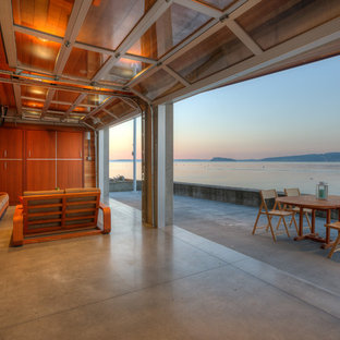 Photo of a small contemporary back patio in Seattle with concrete slabs, an outdoor kitchen and a roof extension.