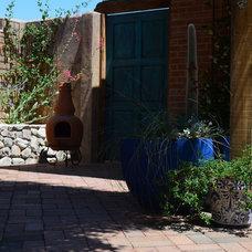 Mediterranean Patio by Landscape Design West, LLC