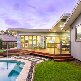 Photo of a mid-sized contemporary backyard patio in Brisbane with decking and a roof extension.