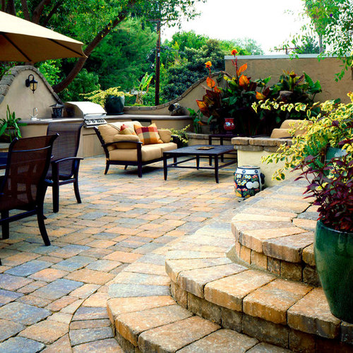 Inspiration For A Mid Sized Mediterranean Patio Remodel In Los Angeles With  Natural Stone Pavers