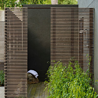 This is an example of a contemporary patio in DC Metro with an outdoor shower.