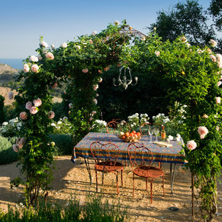 Example of a tuscan patio design in Santa Barbara with no cover