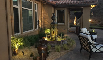 Tuscan lit fountain with bronze path lights and spot lights casting shadows