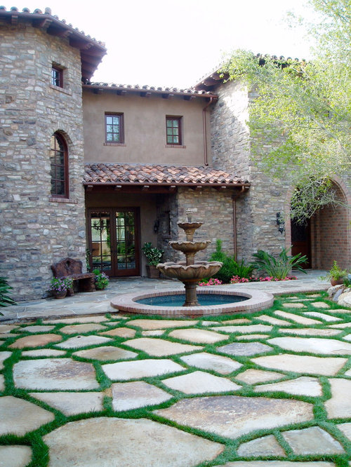 Tuscan courtyards home design ideas pictures remodel and for Courtyard stone landscape