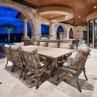 Inspiration for a mediterranean backyard patio kitchen remodel in Houston with a roof extension