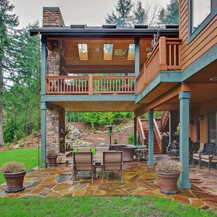 Two Level Deck Mountain Style Patio Photo In Seattle With A Fire Pit