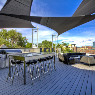 Inspiration for a large contemporary back patio in Denver with an outdoor kitchen, decking and an awning.