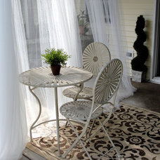 Tropical Patio by Interiors by JC