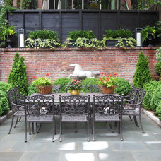 Traditional Patio by r.a.nelson-plantsman