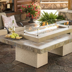 Uptown Fire Pit Table - Featuring a granite supercast and outdoor-grade stucco finish, not to mention how the clean, angular body conceals the liquid propane tank (not included) so neatly, the Uptown Fire Pit Table showcases a stunning fire that is sure to heat up your outdoor space. This two-tier table is functional, as well as beautiful, and makes for a perfect area to entertain. With the addition of firegass, the flame will sparkle and glimmer. Let your next soiree simmer by sitting around the Uptown Fire Pit Table. Your guests will never expect a warming fire to come from the middle of the table, but they'll be thrilled it did.