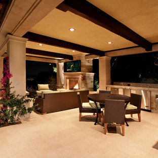 Tuscan patio photo in Los Angeles with a gazebo and a fire pit