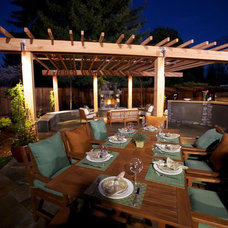 Traditional Patio by Garden LIghts Landscape and Pool Development Inc.