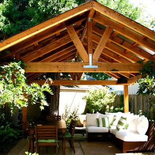 Example of a small urban backyard patio design in Sacramento with a gazebo
